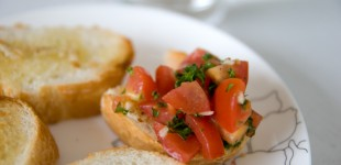 Tomato salad on garlic toasts